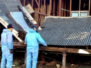 Demolition of house with asbestos roof.